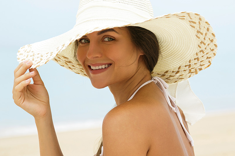 Beautiful woman in beach hat